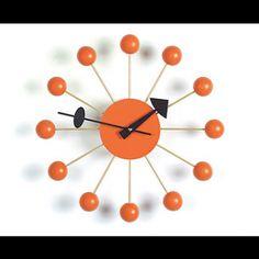 mid-century modern ball clock in orange from Vitra Nelson. At @Design Public