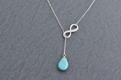 Turquoise  and blinging CZ infinity lariat necklace by Sunrayjewel, $18.50