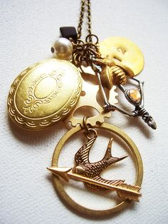 Hunger Games Inspired Charm Necklace; Pearl, Locket, MockingJay, District 12, Bow and Arrow. #HungerGames