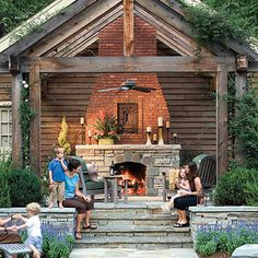 The brick chimney helps to draw the eye up, creating height and keeping the attention on the fireplace, which features a mix                                            of fieldstone and brick for added interest. The entire seating area is elevated, improving views of the surrounding property.                                            A ceiling fan under the arbor assures year-round comfort.