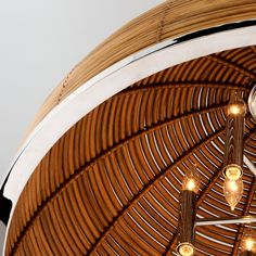 Bring the flair of the tropics to your home, no matter where you are, with the Carayes pendant by Martyn Lawrence Bullard for Corbett Lighting. Hand-cut pieces of sustainable rattan form the large half-dome shaped shade and contrast beautifully with the stainless steel accents. #rattandecor #rattanlighting #bigchandeliers #largechandeliers #designerlighting