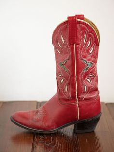 vintage cowboy boots. bright red