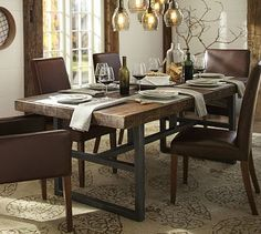 Griffin Fixed Dining Table and Paxton Pendant Light at Pottery Barn. Love the mix of rustic and modern.