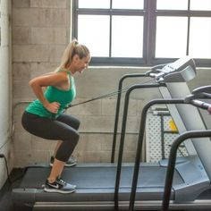 Squat and row: Lower into a squat, bending elbows behind body and pulling handles to sides of torso. Return to standing. Repeat as many times as possible for 60 seconds; move to the next exercise in this circuit.
