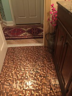 So I finally did a penny floor. I used epoxy from bestbartop.com.  I'm a busy, single mom of six and wasn't sure if I could do this myself. But if you follow the directions exactly, you'll end up with a durable, gorgeous floor. The biggest perk is not grout to clean! My three boys have horrible aim and this wipes up so well no scrubbing involved!