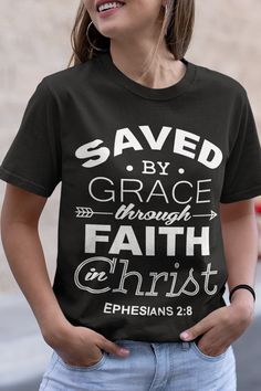 Bible verse t-shirts reads: ''Ephesians Save by grace through Faith in Christ''. This bible verse t-shirt is an easy way to share your Faith and the Word of God with your family and others! Christian Clothing, Christian Shirts, Christian Church, Christian Women, T Shirts With Sayings, Cute Shirts, Jesus Shirts, Saved By Grace, Personalized T Shirts