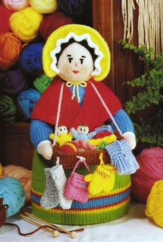 "From Jean Greenhowe's 'Bazaar Knits' collection comes the very serene Pedlar Doll. She is busy selling her wares, which adorn her little tray. Knitted in DK wool she is easy to make (but a little time consuming) and is 29cm/11.5"" tall. Designed and published by Jean Greenhowe Designs in 1990."