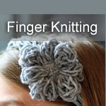 A flowered headband made with finger knitting.