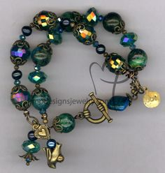 Emerald Elegance ~ Brass Bird Joy hand stamped Gemstone Green Crystal Charm toggle Bracelet Handmade by MP Designs Jewelry