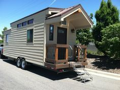 255 Sq. Ft. Dakota Tiny House:  One of my favorite interior tiny houses.  Love the folding steps and hand rails out front and the little storage shed on the back side. http://tinyhousetalk.com/dakota-tiny-houses/
