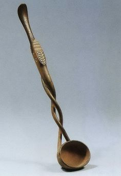 Zulu Tsonga Ladle-   There are perhaps a dozen ladles known to have spirals, which is the likely reason attribution as Tsonga. Above, an example sold at Christies Amsterdam in 2002. Note the serpent (?) at mid section facing away from the bowl.