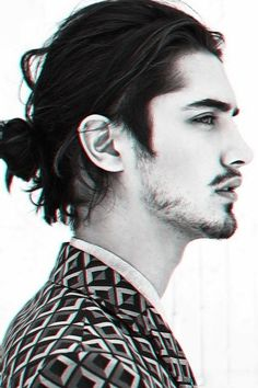I'm not too into the man bun, but this is a well-executed casual low loose one. Attached to a pretty good face.