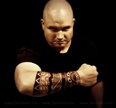 Polynesian Inspired arm cuff on my husband.  Personal meaning: Mountains of challenges he has overcome, His family.  Many rivers, big and small, where he comes from.  Finding calm in the storm.  Solid faith.  His totem is Bear.  The sun shines brightly in his life.  Leaves of growth moving forward.  (No uniquely sacred Polynesian symbols - to my knowledge - were used in the making of this piece.)