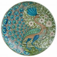 Circa 1888 plate, collection of the V&A Museum, London.  More peacock stuff….love it