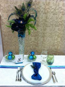 Peacock colored table arrangement.  http://wnyweddingplanner.wordpress.com/