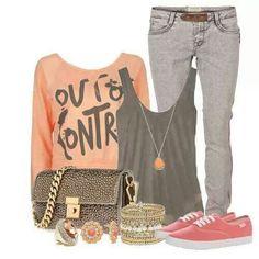Grey shirt, grey pants, orange graphic tee, pink shoes, orange necklace, gold bracelets, gold ring, orange earrings