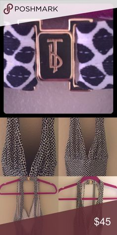 Tory Burch one peice halter swimsuit. GORGEOUS❤️ Very classy, sexy one of a kind swimsuit! Blk and white with rouged butt...low in the back...open back and low front not much padding! To die for!!!! Go for it! Can't go wrong! Pictures do NO justice!!!! Worn one time for about 39 min Tory Burch Swim One Pieces