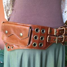 """This Artisan leather utility hip belt was handmade in Nonthaburi, Thailand using the finest quality materials and styling. The """"Jedi"""" has hand tooled brass detailing with """"O"""" ring grommets, studs and"""