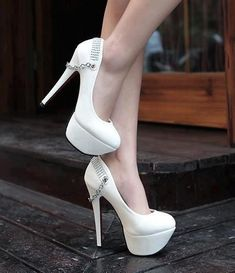 Chain Stilletos the chain makes them badass rocker but the white makes them angelic its like a badass angel shoe! i want!!