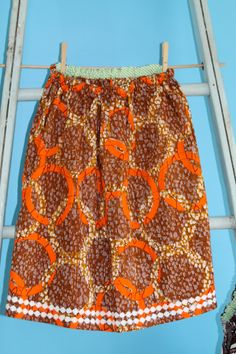 Orange and brown circle African skirt with daisy trim