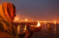 Hindu devotees bathe in the Ganges river in India on the occasion of Makar Sankranti at the Magh Mela. Rishikesh, Makar Sankranti, Haridwar, Mystique, India Travel, Historical Sites, Laos, Cambodia, Tourism