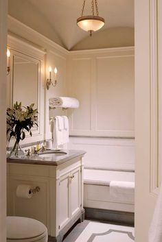 John B. Murray/ how did they do the bottom of the vanity and tub to match the floor? like this with the shower glass panel beside vanity, with line of tile matching floor.