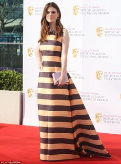 Drawing the lines: Rose, 29, also looked a vision as she opted for a classic red carpet lo...