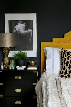 black bedroom with black and white photography art, black campaign style ikea nightstand and yellow headboard Black Bedroom Furniture, Bedroom Black, Kitchen Furniture, Ikea Bedroom, Bedroom Yellow, Black Bedrooms, Gothic Bedroom, Furniture Layout, Cheap Furniture