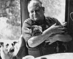 Science Fiction writer Jack Vance with cat and dog.