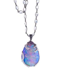 "Katherine Jetter: Exquisite 75ct Lavender Boulder Opal set in 18K White Gold with White and Black Diamonds and Amethyst. 34"" 18K White Gold and Moonstone chain."
