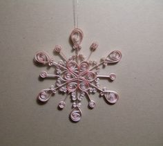 Pretty quilled ornament made by escapingjourney @ etsy