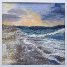 Wet felted wool painting. Inspired by an early evening stroll along the beach as the tide goes out and the setting sun is reflected in the wet sand.