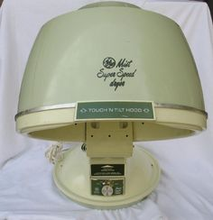 If we didn't want to sleep in curlers we could always just sit under a hair dryer like this. Notice that it is a beautiful avocado green! This was a very popular color in our day....