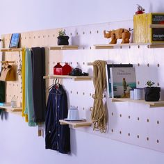 Designed to store and display objects, tools, clothing and artifacts any way you choose. This perforated wooden structure was developed for a range of uses, from the bedroom to the studio, a restaurant to the store. www.georgeandwilly.com