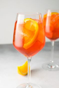 A classic and simple refreshing Italian apertivo cocktail. The Aperol spritz is made with prosecco, aperol, and soda water. Spritzer Drink, Prosecco Drinks, Cocktail And Mocktail, Healthy Cocktails, Cocktail Recipes, Drink Recipes, Healthy Recipes, Refreshing Summer Drinks, Summer Cocktails