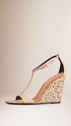 Burberry T-bar wedges in grainy leather with check edging. Covered with a laser-cut lace leather, the platform measures 10cm/3.9in. Discover the shoes at Burberry.com