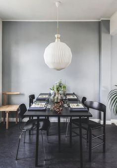 Dining room with a lovely table setting. The table is from Hay surrounded by chairs from Eames. The lamp is an anniversary model from Le Klint