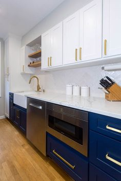 white kitchen with navy base cabinets, microwave cabinet next to stainless dishwasher and wood floating shelves above the sink Open Galley Kitchen, White Galley Kitchens, White Kitchen Appliances, Galley Kitchen Design, Galley Kitchen Remodel, Kitchen And Bath Design, Home Kitchens, Gally Kitchen, Dad's Kitchen
