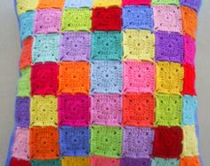 the 25 colors in grey edging granny square by handmadebyria