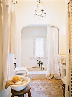 An original sunken, tiled tub anchors the bath, and floor tiles salvaged from a European villa accentuate the old-world feel.Love the honeycomb tile on the floor. (Photo: Megan Thompson)