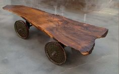 One giant slab of historic wood on antique cast iron thrasher wheels. Wooden Tables, Dining Tables, Coffee Tables, Wagon Wheel, Woodworking Workshop, Salvaged Wood, Wood Slab, Diy Wood Projects, How To Distress Wood