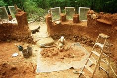 I just love this picture of a woman working on building her home by hand