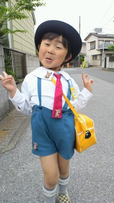 A Japanese boy in his nursery school uniform.