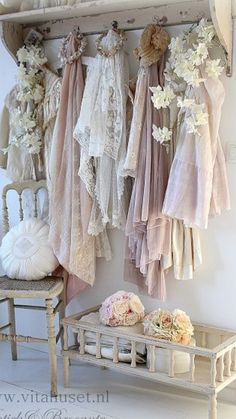 You don't need to find antique dresses to hang. Just use lacey fabrics.