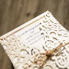 ivory vintage glittery laser cut wedding invitations with twine and soft pink flower EWWS101