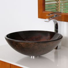 Add warm, sophisticated color to your bathroom decor with this modern vessel sink. This stunning bathroom sink is crafted of solid tempered glass and features a swirling bronze finish for a unique artistic effect.