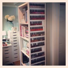 mint walls, amazing nail polish storage, and the drawers in back .