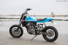 A Ducati 848 with a streetfighter vibe, a KTM 640 rebuilt in the tracker style, an e-bike homage to a surfing legend, and a pair of lunatic snow bikes. Ktm Motorcycles, Ducati 848, Cafe Racer Magazine, Flat Tracker, Blue Flats, Dirt Bikes, Scrambler, Custom Bikes, Bobber