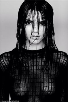 Racy: In her new modelling shot, Kendall's Jenner breasts are exposed under a sheer black jumper as her dark eyes pierce through the camera lens