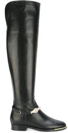 Versace Medusa strap riding boots. Riding boot fashions. I'm an affiliate marketer. When you click on a link or buy from the retailer, I earn a commission.
